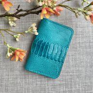 Cardholder in turquoise genuine ostrich skin. Slim card wallet. Minimalist turquoise bifold card case.