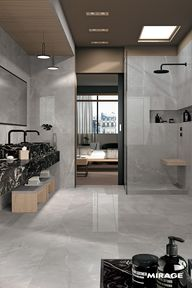The suites allow us to interpret the Mirage products in a totally new way. The use of large slabs lets your Creativity run wild for shower cubicles, vanity tops, stools and shelves. Thanks to the particular characteristics of porcelain stoneware and the reduced presence of joints, it is easier to maintain and keep clean. #woodtiles #woodeffect #marbleeffect #marbletiles #interiordecor #interiorinspiration #hotellerie #hotelleriedeluxe #hotelaria #hotelier #hall #suite