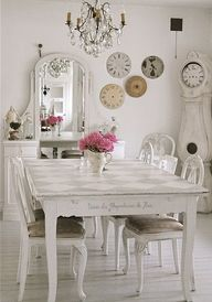 Shabby Chic Decorating Ideas. White interior, dining room, table, grandfather clock, chadelier, dresser with mirror. checkered table surface is a nice detail (matte/shiny white paint), clock faces on the wall.