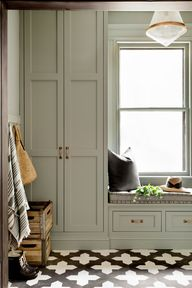 Whether youre leaning towards a softer sage green shade or plan to go bold with a dark emerald green, both light and dark green kitchen cabinets can create a fresh look.  #greenkitchencabinets #painted #paintcolors #ideas #bhg