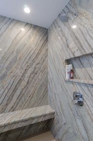 Shower Idea - granite shower walls and seat, built in shower cubbie, glass shower doors.
