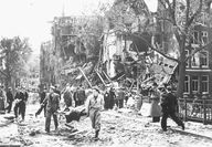 May 11, 1940. A German bomber aircraft was hit by anti-aircraft artillery at Sloterdijk. The plane flew on, but managed to drop two bombs. They landed in the center of Amsterdam. One bomb ricocheted off a bridge into water, but another bomb dropped on a row of terraced houses at the Blauwburgwal. #amsterdam #wordwar2
