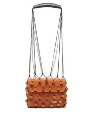 DESCRIPTION This Perola bag from Jacquemus consists of a brown leather envelope clutch thats covered with a beaded macramé netting. Made in France,its decorated with a gold-tone metal logo plaque and wooden cubes that are reminiscent of the geometric details that run throughout the SS18 collection. Swing it alongside one of the smart neutral edits from the label.