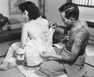 c.1950s: Tattooing a