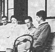 Hochreit 1920. Wittgenstein is seated between his sister, Helene and his friend, Arvid Sjögren.