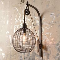 "Form and function combine in a unique industrial design with a  metal wire sphere and rubbed bronze finish. This wall mounted light fixture has a pulley and cleat mechanism  which raises and lowers the functional wire cage to direct light on your reading material or nightstand. Cord and plug allows the user flexibility to install anywhere there is an outlet. 10.5 of brown cord fabric cord. Rotary on-off in line cord switch 28"" from plug. 40W max, medium base socket."