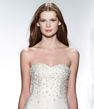 How exquisite is the bodice beading on this strapless Christos gown?