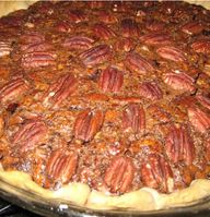 This delicious pie sits in a pastry crust. The simple surprise flaor is a bit of orange zest. Fresh pecans added to brown sugar and corn syrup  won't disappoint!