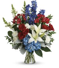Perfectly patriotic with its red, white and blue blooms, this bold bouquet of hydrangea, lilies and roses is a versatile tribute on any occasion.  T282-2B, Vase, Red White and Blue