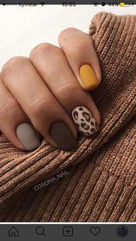 Matte fall colors with featuring a leopard print design #fallnails #mattenails #leopardprint #nails #nailart