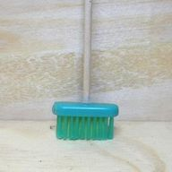 Broom made with toothpick and toothbrush head
