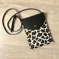 Leopard print hair on hide cross body bag/ belt bag/ fanny pack. Leopard sling bag.