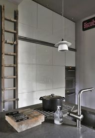 Vintage kitchen with a wooden ladder and a coffee cup using as a suspended light