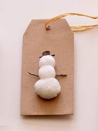 Three White Pom-Poms = Snowman Gift Tag