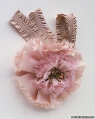 Ribbon Flower Corsage    Give your bridesmaids a fashionable floral accessory that will look fresh long after the wedding day: wrist corsages made with silk ribbon flowers. They can even be tied around a ponytail or worn as brooches. These corsages are easy to make: Tie elastic ribbon around your wrist in a big bow, then pin the bloom to the knot.