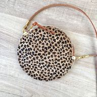 Leopard print hair on hide circle bag