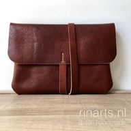 Brown leather envelope wrap clutch