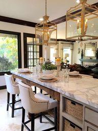 Kitchen lighting, counter top, upholstered stools, black trim