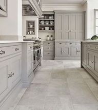Not every gray / grey kitchen cabinets need wood floors; this kitchen has tile flooring with a modern traditional style. #kitchenideas #kitchendesign #kitchenflooring #kitchenflooringwithwhitecabinets