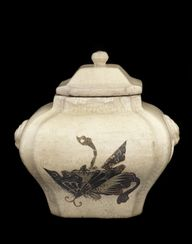 Lidded jar with desi