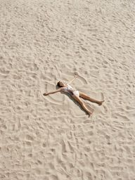 Make sand angels on