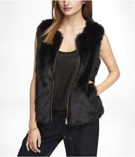 faux fur zip up vest...