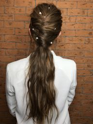 chignon ponytail for ling hair with pearl details