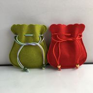 Wool felt drawstring pouches in several colors