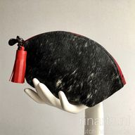 Black hair on hide zipper pouch with red tassel