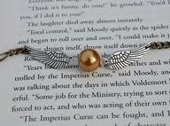 Snitch necklace.