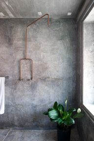 Cement wall shower with copper fittings
