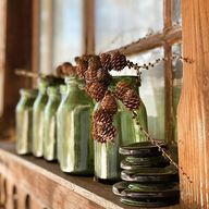 You know how when you go past something every day for a long time you eventually stop seeing it? .  . I stopped in my tracks on the steps leading to our back door because I suddenly noticed these green bottles. They have been sitting on that outdoor window ledge for years (as has the dirt on the windows ) One of my lovely family had put a branch of my favourite pine cones up there and it made me smile that they had popped it there as if on display. It was definitely one of those #heitermoments f