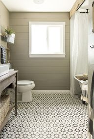 Love the tile and the board covering up the shower curtain bar. also, the colors and the sink is really great.