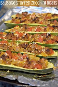 Sausage Stuffed Zucchini Boats are stuffed with sausage, tomatoes, onions, and more. Theyre good for keto and WW. Get the recipe at www.drugtoredivas.net.