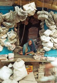 Selling paper bags made out of old newspapers. India i way ahead as far as recycling is concerned.