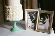 Vintage photos of the couple's parents cake-cutting on their wedding day make a sweet touch next to a simple, frilly cake. (At @Four Seasons Resort The Biltmore Santa Barbara)