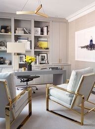 The study is packed with luxe details, including a gray leather hand-stitched desk and a pair of suede-and-brass club chairs.