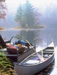 """Canoe in lake"" by M"