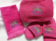 "Pamper the special lady in your life with our pink ""Its Not Easy Being A Princess"" gift set. Includes slippers, a cotten fingertip towel and cosmetic bag."