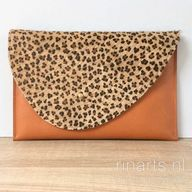 Cognac leather clutch with leopard hair on hide flap