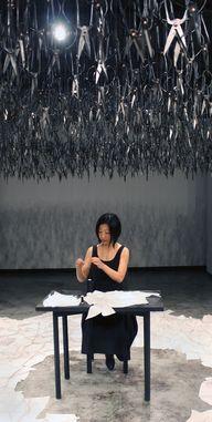 A woman sits silentl