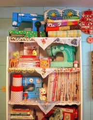 Retro colourful craft storage space. Love the colourful sewing machines including a Hello Kitty one