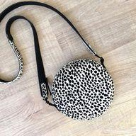 Cheetah print hair on hide circle bag in black and white