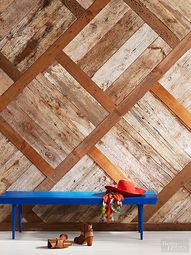 There are lots of great ways to achieve a salvaged theme in your home, including reclaimed wood projects. Put on your DIY hat and pick up some cheap reclaimed wood to cover everything from floors to ceilings.