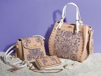 "Greek Spirit / GREEK SPIRIT Inspired by the sea`s deep blue and Greek island`s white, our new 'Greek Spirit' collection will virtually tour you to the Aegean and Ionian islands. The slogan of the line is ""My Greek Island Home"" and ""Olive Branch with a Mediterranean Flair"". Stunning handmade engraved details and prints on bags and wallets embellish our new collection. www.doca.gr"