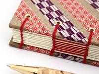 handmade books and journals, with an emphasis on technical bookbinding, decorative stitching and colorful books