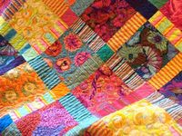 I love Quilts, I am a Quilter and I collect old quilts. I love to look at others quilting art.