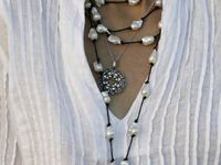 Handcrafted jewelry specializing in fused glass and memory pendants.