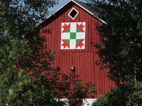 Barns with Painted Quilts