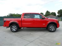 Red Coloured Ford F 150 Trucks
